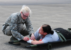 "U.S. Air Force Senior Airman Megan Dolash, a medical technician with the 118th medical group, Tennessee Air National Guard tends to a cadet from Volunteer Challenge Academy at a mass casualty event during the Shaken Fury exercise at Smyrna Airport, Smyrna, Tennessee, June 1, 2019. Shaken Fury is a Federal Emergency Management Agency led exercise simulating a catastrophic earthquake along the New Madrid Seizmic Zone (NMSZ) near Memphis, Tennessee. The purpose of the exercise is to examine and improve the community's response to a ""no-notice"" earthquake, recognize shortfalls in resources, and develop a coordinated recovery plan. (U.S. Air National Guard photo by Master Sgt. Jeremy Cornelius/RELEASED)"