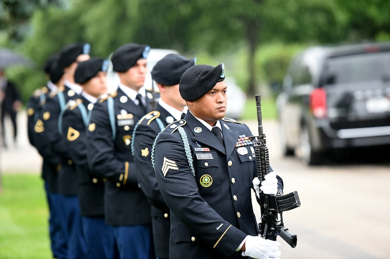 Soldiers assigned to the 101st Airborne Division render a salute with their weapons during the graveside service of Staff Sgt. Al Mampre at Memorial Park Cemetery in Skokie on Saturday, June 15, 2019.