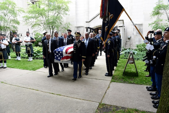 Pallbearers carry the casket of Staff Sgt. Al Mampre to a waiting hearse following a funeral service on Saturday, June 15, 2019, at St. Luke's Episcopal Church in Evanston.