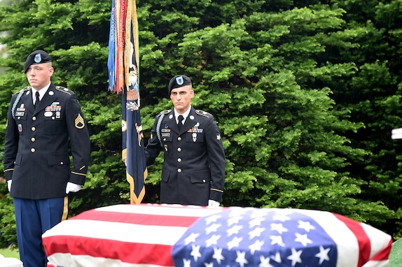 Soldiers assigned to the 101st Airborne Division stand over a casket during the graveside service of Staff Sgt. Al Mampre at Memorial Park Cemetery in Skokie on Saturday, June 15, 2019.