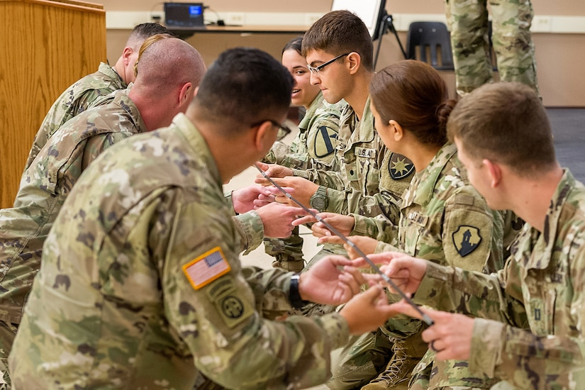 Soldiers from various units take part in a teambuilding event during the first day of Diamond Saber at Fort McCoy, Wisc., June 18, 2019. Diamond Saber, the Army's only major financial management exercise, is designed to provide realistic technical training to regular Army, Army Reserve and Army National Guard FM units through interactive scenarios and transactions based upon current policy in a collective environment. (U.S. Army photo by Russell Gamache)