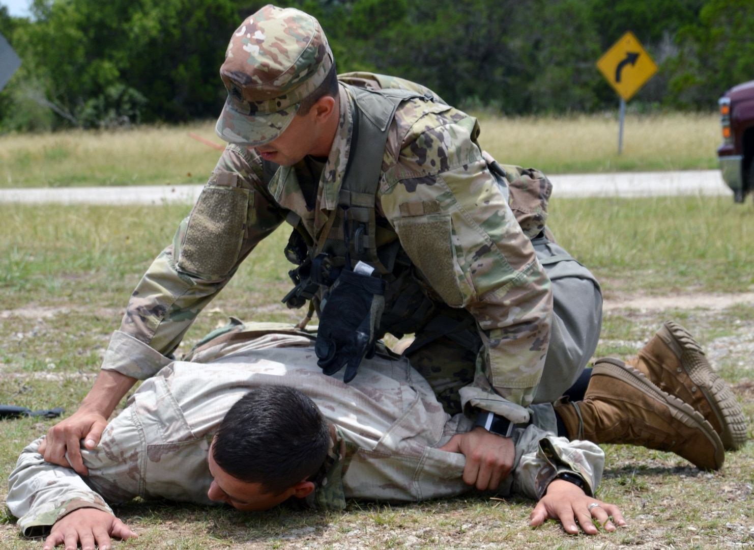 Army Sgt. Kevin Ramirez takes down an aggressor during the tactical road march portion of the Brooke Army Medical Center Best Medic Competition at Joint Base San Antonio-Camp Bullis June 12. The competitors were tested on both warrior and medic skills during the competition.