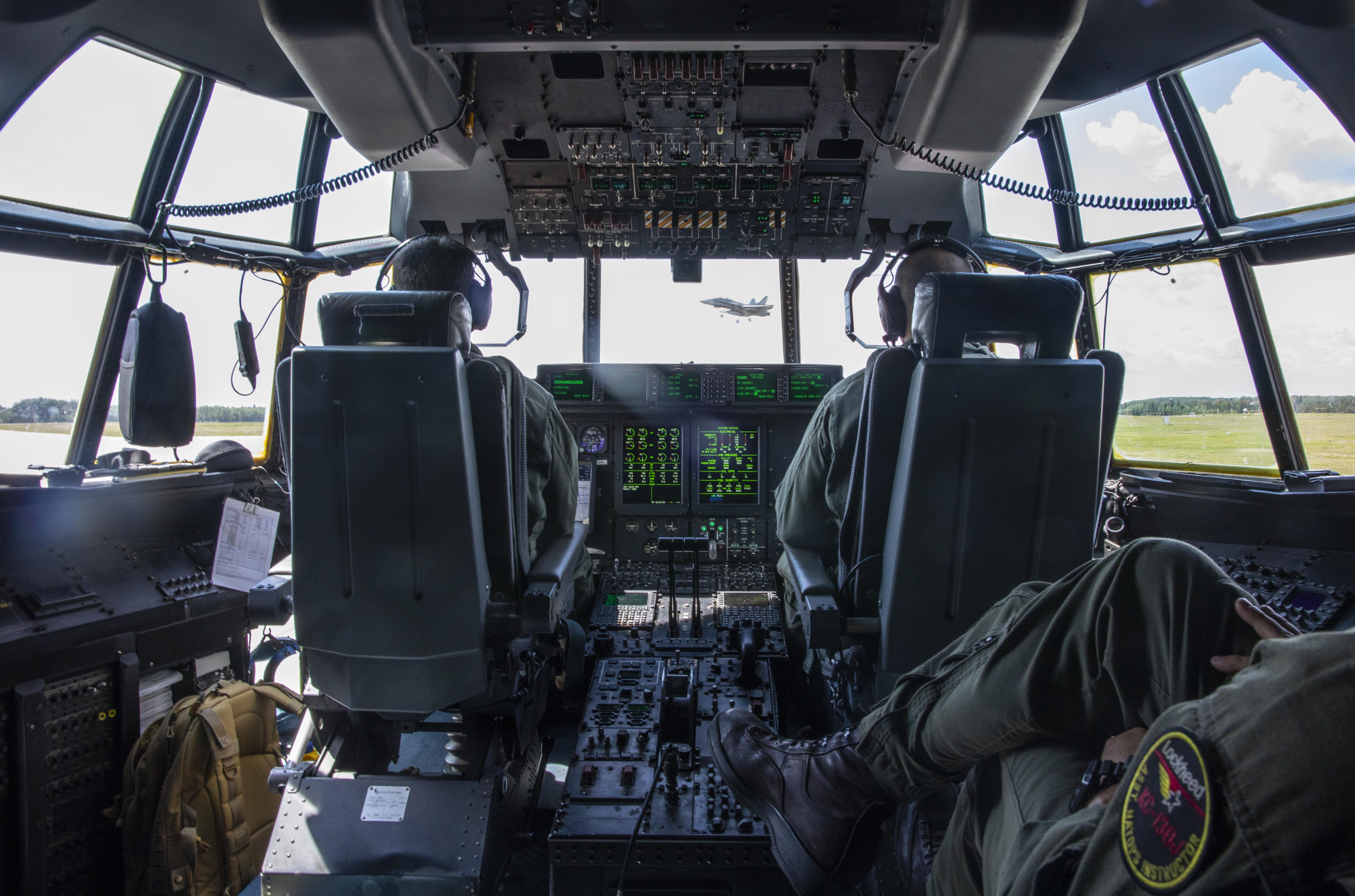 U S  Marine Corps KC-130 Hercules refuel Canadian aircraft