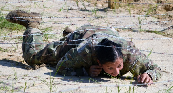 Army 1st Lt. Samantha Frank low crawls during the Brooke Army Medical Center Best Medic Competition at Joint Base San Antonio-Camp Bullis June 12. BAMC Soldiers competed for the title of Best Medic during the grueling competition with included an obstacle course.