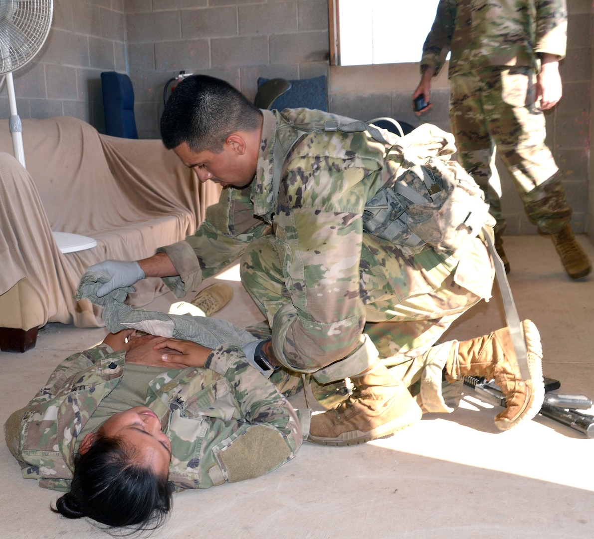 Army Sgt. Kevin Ramirez assesses a casualty during the tactical combat casualty care portion of the Brooke Army Medical Center Best Medic Competition at Joint Base San Antonio-Camp Bullis June 12. The competitors were tested on both warrior and medic skills during the competition.