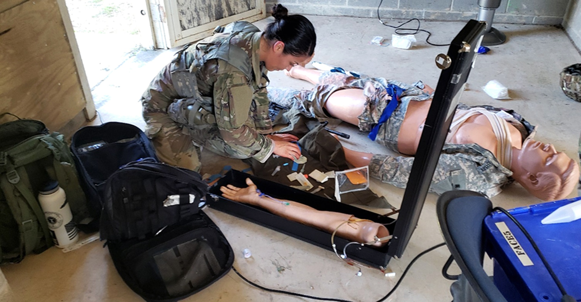 Army Sgt. Samantha Delgado assesses a patient during the medical lane portion of the Brooke Army Medical Center Best Medic Competition at Joint Base San Antonio-Camp Bullis June 12. The Soldiers competed in several warrior and medical tasks during the grueling competition.