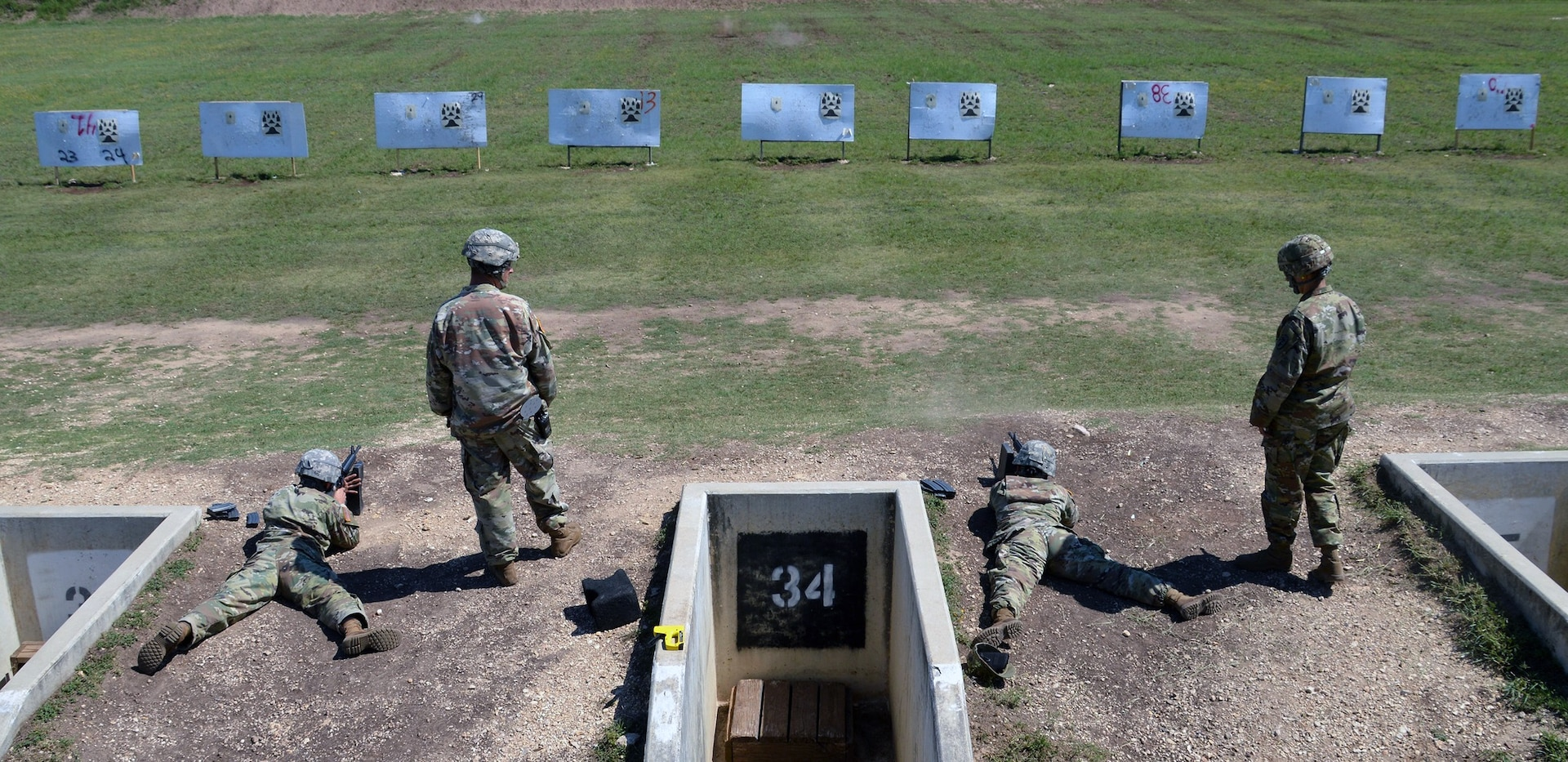 Soldiers participate in an M-16 qualification during the Brooke Army Medical Center Best Medic Competition at Joint Base San Antonio-Camp Bullis June 13. The competitors were tested on both warrior and medic skills during the competition.