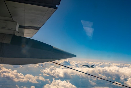 U.S. Marine Corps KC-130 Hercules refuel Canadian aircraft in the air