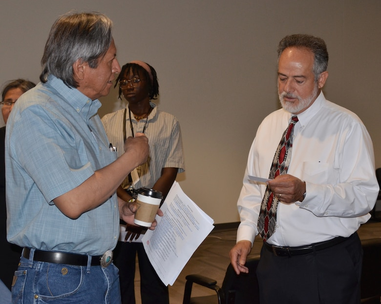 ALBUQUERQUE, N.M. -- William Frazier, (left), site manager with the Dept. of Energy's Office of Legacy Management, speaks with Phillip Roybal, architect in the Albuquerque District's Construction Branch, during a workshop for Military and Interagency and International Services stakeholders, June 12, 2019. The workshop was designed to give stakeholders a better understanding of what services the Albuquerque District provides, and how the district operates and conducts business.