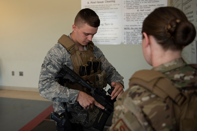 U.S. Air Force Airman 1st Class Christopher Shaffer, 60th Security Forces Squadron installation patrolman, clears his M4 rifle June 18, 2019, at Travis Air Force Base, California. Security Forces Airmen like Shaffer are responsible for protecting resources and personnel for the Air Force's largest air mobility wing. (U.S. Air Force photo by Tech. Sgt. James Hodgman)