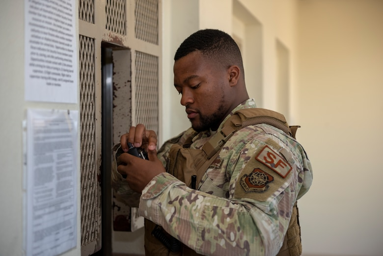 Senior Airman Kelly Goodwin, 60th Security Forces Squadron installation patrolman, checks his radio after receiving it from the armory June 18, 2019, at Travis Air Force Base, California. Security Forces Airmen like Goodwin are responsible for protecting resources and personnel for the Air Force's largest air mobility wing. (U.S. Air Force photo by Tech. Sgt. James Hodgman)