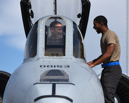 U.S. Air Force Senior Airman Laurence Tinson, right, a dedicated crew chief assigned to the 51st Aircraft Maintenance Squadron, and Maj. Philip Budenbender, a pilot assigned to the 25th Fighter Squadron, talk before takeoff during RED FLAG-Alaska 19-2 at Eielson Air Force Base, Alaska, June 11, 2019. RF-A provides unique opportunities to integrate various forces into joint operations training with real-life scenarios. The 51st AMXS and 25th FS are from Osan Air Base, Republic of Korea. (U.S. Air Force photo by Staff Sgt. Sergio A. Gamboa)