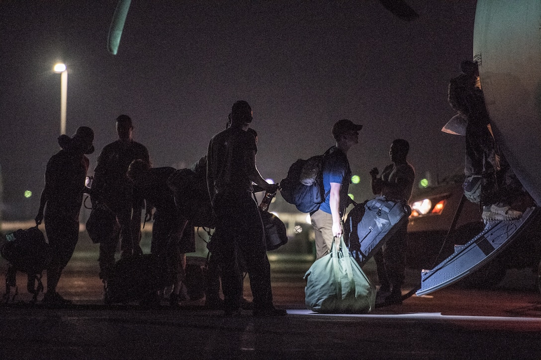 U.S. Air Force Airmen assigned to the 75th Expeditionary Airlift Squadron board a C-130J Super Hercules at Camp Lemonnier, Djibouti, June 5, 2019. The 75th EAS provides support in medical evacuations, disaster relief, humanitarian and airdrop operations. (U.S. Air Force photo by Staff Sgt. Devin Boyer)