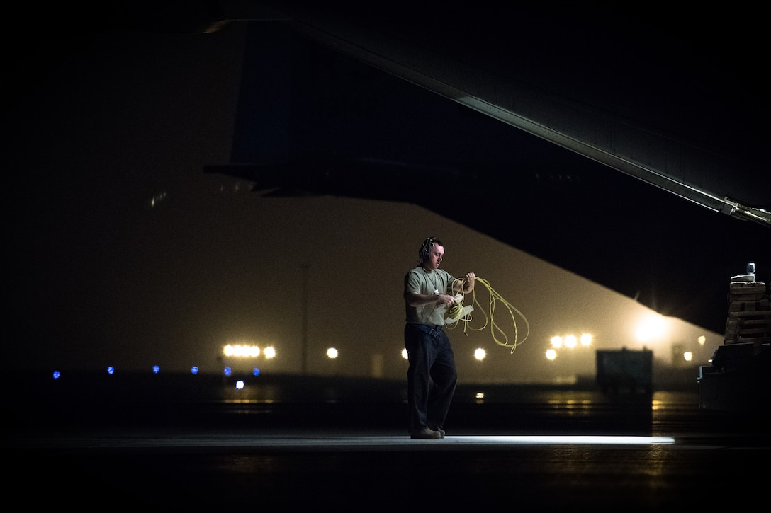 U.S. Air Force Staff Sgt. Darren Breton, 75th Expeditionary Airlift Squadron crew chief, prepares a C-130J Super Hercules for flight at Camp Lemonnier, Djibouti, June 5, 2019. The 75th EAS provides support in medical evacuations, disaster relief, humanitarian and airdrop operations. (U.S. Air Force photo by Staff Sgt. Devin Boyer)