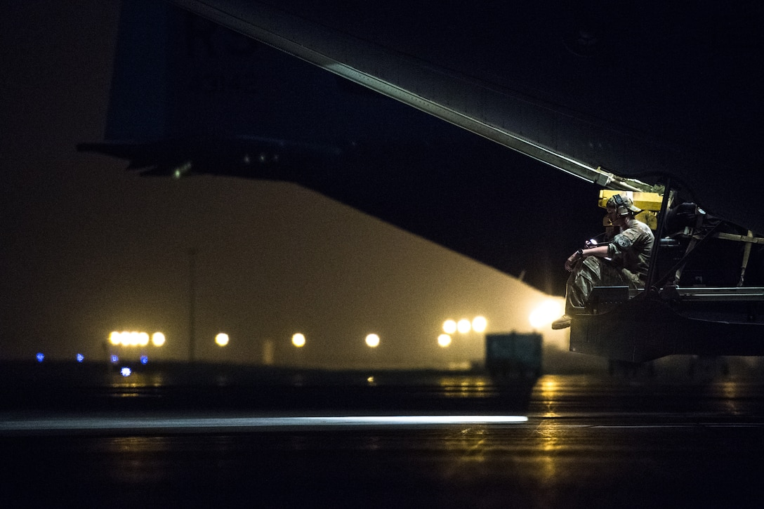 U.S. Air Force Staff Sgt. Dillon Lafond, 75th Expeditionary Airlift Squadron loadmaster, sits on the back of a C-130J Super Hercules before flying out of Camp Lemonnier, Djibouti, June 5, 2019. The 75th EAS provides support in medical evacuations, disaster relief, humanitarian and airdrop operations. (U.S. Air Force photo by Staff Sgt. Devin Boyer)