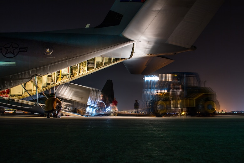 U.S. Air Force Airmen assigned to the 75th Expeditionary Airlift Squadron load a generator onto a C-130J Super Hercules at Camp Lemonnier, Djibouti, June 5, 2019. The 75th EAS provides support in medical evacuations, disaster relief, humanitarian and airdrop operations. (U.S. Air Force photo by Staff Sgt. Devin Boyer)