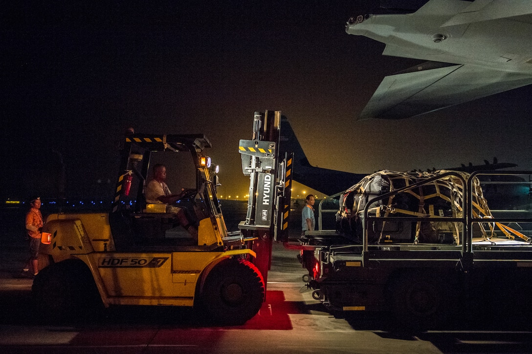 An air operations member loads luggage onto a C-130J Super Hercules with the help of 75th Expeditionary Airlift Squadron Airmen at Camp Lemonnier, Djibouti, June 5, 2019. The 75th EAS provides support in medical evacuations, disaster relief, humanitarian and airdrop operations. (U.S. Air Force photo by Staff Sgt. Devin Boyer)