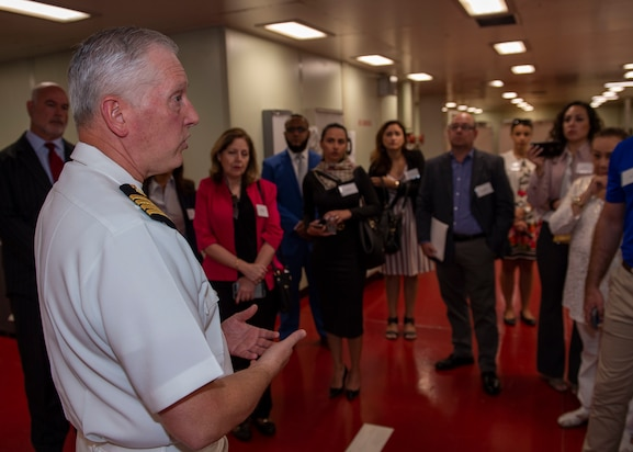 Capt. Kevin P. Buss, director of nursing services, guides a tour of the hospital ship USNS Comfort (T-AH 20). C