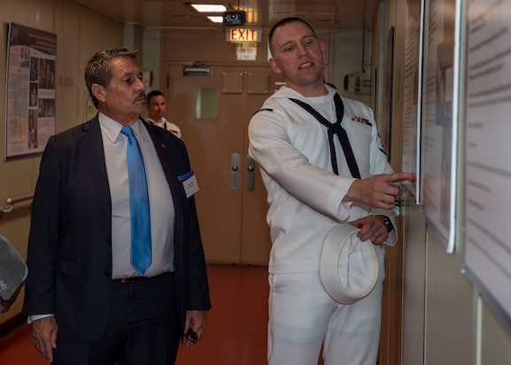 Hospital Corpsman 3rd Class Justin Bock guides a tour of the hospital ship USNS Comfort (T-AH 20).