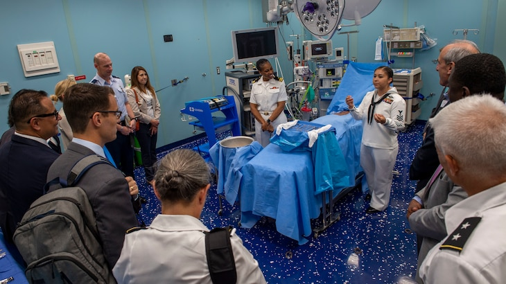 Hospital Corpsman 1st Class Edna Wallace from El Paso, Texas, and Lt. Gwendolyn Mann, from Hampton, Va., guide a tour of the hospital ship USNS Comfort (T-AH 20).