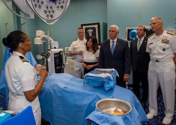 Lt. Gwendolyn Mann, from Hampton, Va., shows Vice President Mike Pence and second lady Karen Pence an operating room during a tour of the hospital ship USNS Comfort (T-AH 20).