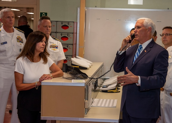 Vice President Mike Pence speaks to the crew over the announcing system aboard hospital ship USNS Comfort (T-AH 20).
