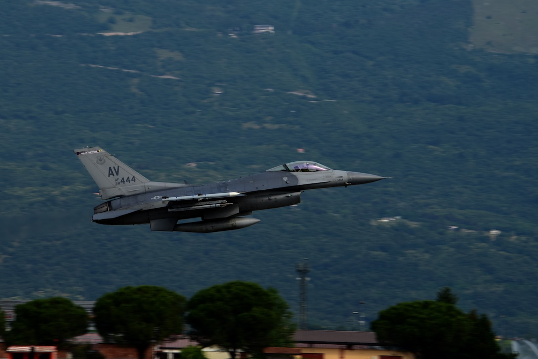 An F-16 Fighting Falcon from the 31st Fighter Wing takes off from Aviano Air Base, Italy, June 19, 2019. The 31st Fighter Wing boasts a diverse combat mission set including the 555th and 510th Fighter Squadrons, 56th and 57th Rescue Squadrons and the 606th Air Control Squadron. (U.S. Air Force photo by Airman 1st Class Caleb House)