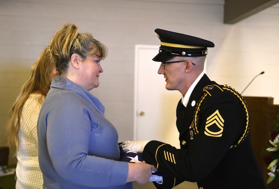 Shelley Statler, pictured receiving the flag from a member of the Wyoming Army National Guard Military Funeral Honors team.