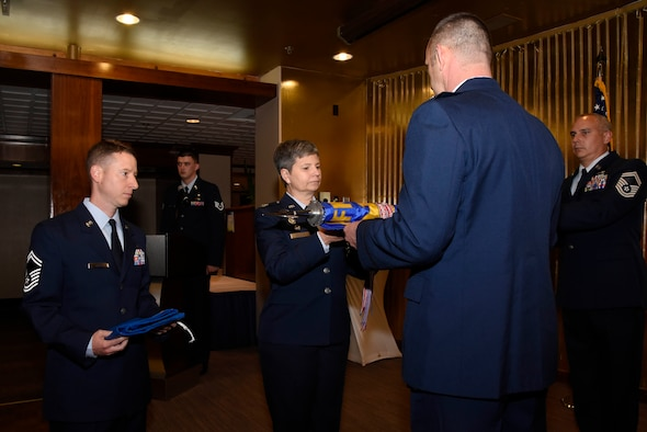 Lt. Col. Ryan Caulk (right), 4th Manpower Requirements Squadron commander, inactivates command of the squadron June 17, 2019 at The Club on Peterson Air Force Base, Colorado. The squadron is now under the direction of the Air Force Manpower Analysis Agency and has become an Operating Location. Throughout its existence, the squadron earned two Air Force Outstanding Unit Awards and three Air Force Organizational Excellence Awards. (U.S. Air Force photo by Staff Sgt. Alexandra M. Longfellow)