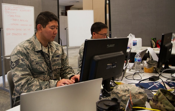Staff Sgt. Marc Masuno from Aiea, Hawaii, and Hawaii Air Guard Cyber Mission Assurance Team works on his computer during the exercise portion, a scenario-based cyber security role-playing event, at Cyber Shield 19 at Camp Atterbury, Ind., April 16, 2019.  Cyber security is fundamental to enabling the Army's offensive and defensive activities in order to win in and through cyberspace.