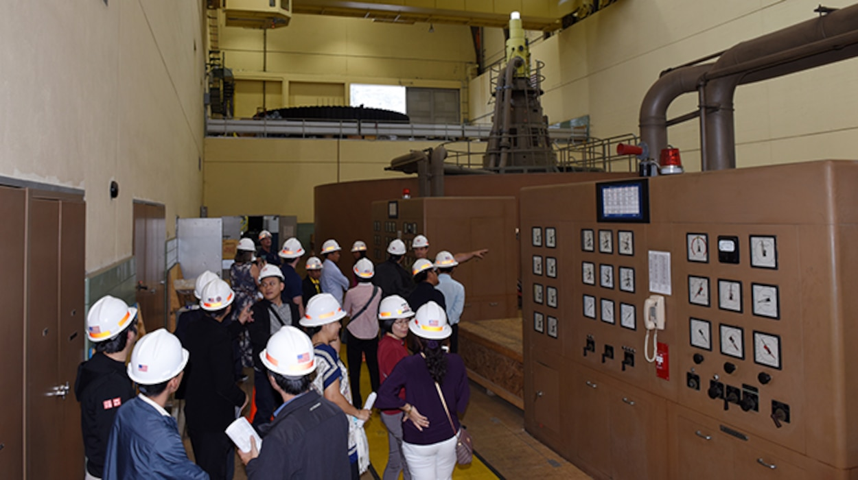 Will Garner, senior hydropower plant operator, leads the Lower Mekong Initiative contingent on a tour of the Old Hickory Power Plant in Hendersonville, Tenn. (USACE photo by Lee Roberts)