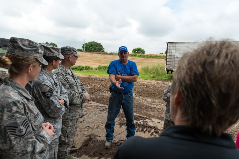 Wayne Lohmann, a farmer at Lohmann Farms, discusses dairy operations with U.S. Air Force public health professionals and representatives from the Cape Girardeau County Public Health Commission during a site visit in Perryville, Mo., June 18, 2019. Airmen deployed in support of Delta Area Economic Opportunity Corporation Tri-State Innovative Readiness Training 2019 coordinated with civilian public health agency partners to view livestock processes and promote interagency cooperation. (U.S. Air National Guard photo by Senior Airman Jonathan W. Padish)