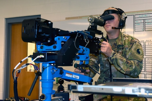 Spc. Erik Murphy, a cavalry scout with the Virginia Army National Guard's Troop B, 2nd Squadron, 183rd Cavalry Regiment, engages targets with an M2 .50 caliber machine gun on the Individual Unstabalized Gunnery Trainer during training at the Suffolk Armory in Suffolk, Virginia, June 8, 2019. The IUGT is a computer-based simulator that connects the body of a weapon to a virtual reality system and is used to augment the training on crew-served weapons.