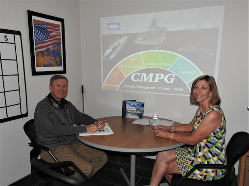 Acquisition policy community of practice team members, Wanda Cutchin and Tim Reed pose for a photo at Naval Surface Warfare Center Panama City Division. Cutchin and Reed were instrumental in the creation and continuation of the Naval Sea Systems Command Contract Management Process Guide.