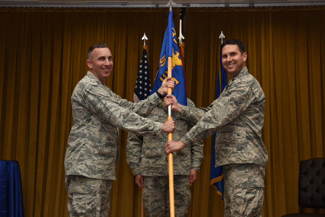 Col. Christopher Estridge, 39th Medical Group commander, left, gives command to Lt. Col. Robert Orlando, 39th Medical Support Squadron commander, during the squadron's change of command ceremony June 13, 2019, at Incirlik Air Base, Turkey. Orlando comes to the 39th MDSS after being the medical readiness flight commander at the 88th Medical Support Squadron, Wright-Patterson Air Force Base, Ohio. (U.S. Air Force photo by Staff Sgt. Matthew J. Wisher)