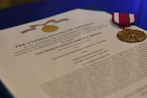 A Meritorious Service Medal lays on a table during the 39th Medical Support Squadron change of command ceremony June 13, 2019, at Incirlik Air Base, Turkey. This medal was awarded to Lt. Col. Jason Telfer after he generated approval for projects worth approximately $7.5 million, as well as provided healthcare to approximately 4,200 U.S. and coalition forces. (U.S. Air Fore photo by Staff Sgt. Matthew J. Wisher)