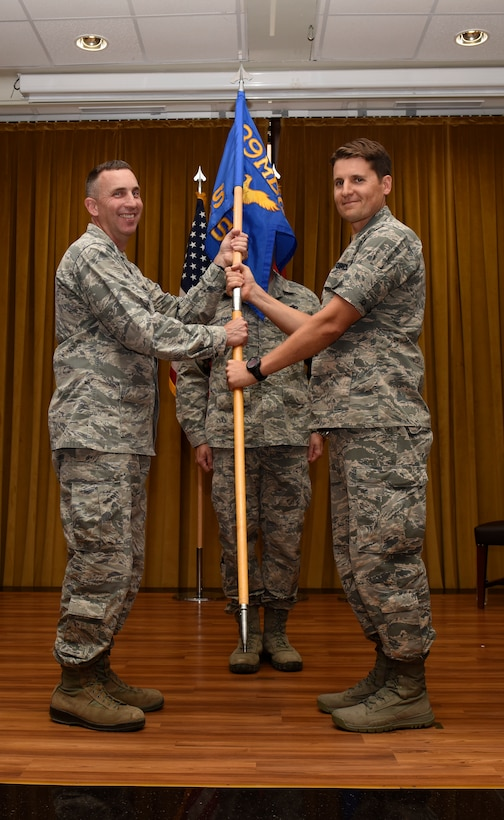 Lt. Col. Jason Telfer, 39th Medical Support Squadron commander, right, relinquishes command to Col. Christopher Estridge, 39th Medical Group commander, left, during the change of command ceremony June 13 2019, at Incirlik Air Base, Turkey. During his tenure, Telfer provided healthcare to approximately 4,200 U.S. and coalition forces stationed at Incirlik Air Base. (U.S. Air Force photo by Staff Sgt. Wisher)