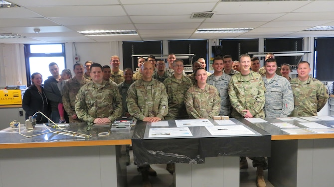 48th Component Maintenance Squadron Electrical and Environmental shop pose for a group photo with Chief Master Sgt. Daniel Guzman, U.S. Air Forces in Europe first sergeant, at Royal Air Force Lakenheath, England, May 17, 2019. The E&E shop won two of four 2018 Wing Innovation Madness awards, which contributed to the 48th Fighter Wing 2018 Innovation Madness win at the U.S. Air Forces in Europe Africa Command level for which the wing was highlighted for saving a total of $11 million and 1.4 million man-hours. (Courtesy photo)