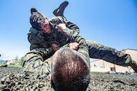 "U.S. Marine Corps Lance Cpl. Jacob Wren, air traffic controller with Headquarters and Headquarters Squadron, Marine Corps Air Station Camp Pendleton, attempts to perform the ""counter to the mount"" technique during Marine Corps Martial Arts Program training at the MCAS Camp Pendleton MCMAP pit, June 19, 2019. Around the base, Marines conduct MCMAP training to strengthen their abilities in hand-to-hand combat and build their warrior ethos."