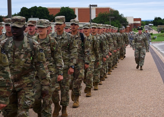 U.S. Army Staff Sgt. Sarah Artman, 344th Military Intelligence Battalion Company A drill sergeant, marches her student platoon from their signal intelligence analyst course to the Western Winds Dining Facility on Goodfellow Air Force Base, Texas, June 18, 2019. Drill sergeants develop military professionals through disciplinary techniques, such as being marched to lunch, during the Soldiers' 24-week Advanced Individual Training on Goodfellow. (U.S. Air Force photo by Airman 1st Class Abbey Rieves/Released)