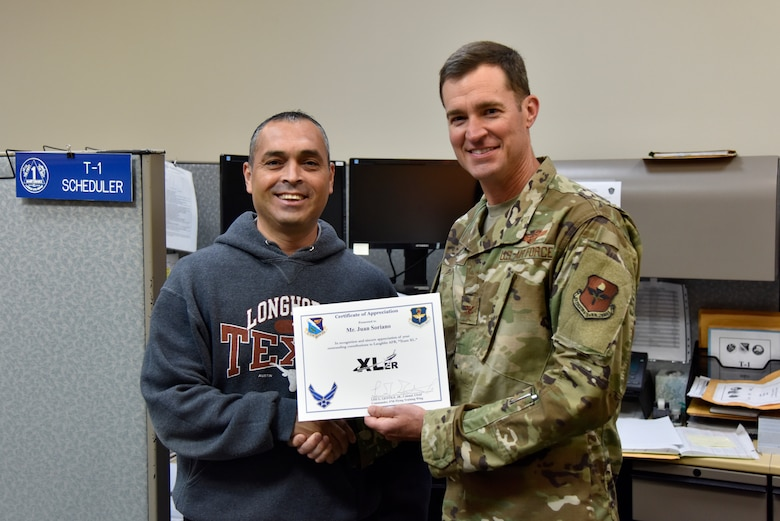 "Juan Soriano, 47th Maintenance Directorate Plans and Scheduling work lead, was chosen by wing leadership to be the ""XLer"" of the week, for the week of June 10, 2019 at Laughlin Air Force Base, Texas. The ""XLer"" award, presented by Col. Todd Dyer, 47th Flying Training Wing vice commander, is given to those who consistently make outstanding contributions to their unit and the Laughlin Mission. (U.S. Air Force photo by Senior Airman John A. Crawford)"