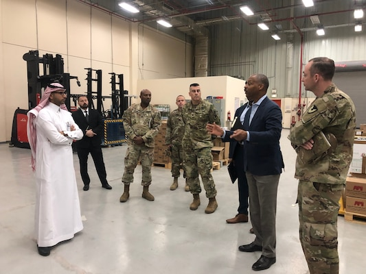 Peter Skillings, DLA Troop Support Medical's Collective and Foreign Military Sales branch chief, speaks to representatives of the Saudi Arabia National Guard Health Affairs during a warehouse tour at Riyadh, Saudi Arabia May 2019.
