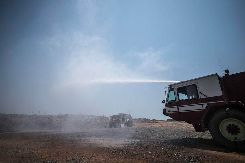 U.S. Air Force Airman 1st Class Anthon Williams, 870th Air Expeditionary Squadron firefighter, tests a fire truck hose at Chabelley Airfield, Djibouti, June 11, 2019. The 870th AES firefighters support the mission in East Africa by providing emergency services to the 449th Air Expeditionary Group and their assets. (U.S. Air Force photo by Staff Sgt. Devin Boyer)