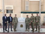 Peter Skillings, DLA Troop Support Medical's Collective and Foreign Military Sales branch chief, left, and Abin Mathai, DLA Troop Support Medical's Dressing, Tools and Instruments integrated support team chief, second to left, pose for a photo in Riyadh, Saudi Arabia May 2019.