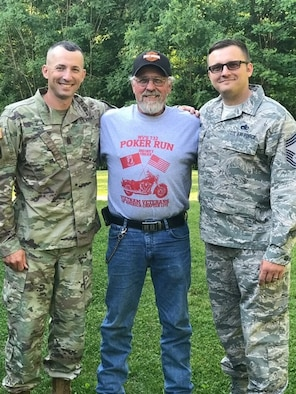 Command Sgt. Maj. Dusty Jones and Chief Master Sgt. Eric Jones pose for a photo with their father, Steve Jones. Steve is an influential part of their lives and is crediting with their successful rise in the ranks of the West Virginia National Guard. (Courtesy photo)