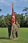 U.S. Marine Corps Lt. Col. Robert P. Gerbracht, left, commanding officer of 8th Engineer Support Battalion, 2nd Marine Logistics Group, receives the unit colors from Lt. Col. Patrick G. Manson during a change of command ceremony at Camp Lejeune, North Carolina, June 19, 2019. During the ceremony, Manson relinquished command of 8th ESB to Gerbracht.   (U.S. Marine Corps photo by Gunnery Sgt. Jason W. Fudge)
