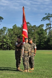 U.S. Marine Corps Lt. Col. Robert P. Gerbracht, left, commanding officer of 8th Engineer Support Battalion, 2nd Marine Logistics Group, receives the unit colors from Lt. Col. Patrick G. Manson during a change of command ceremony at Camp Lejeune, North Carolina, June 19, 2019. During the ceremony, Manson relinquished command of 8th ESB to Gerbracht. 