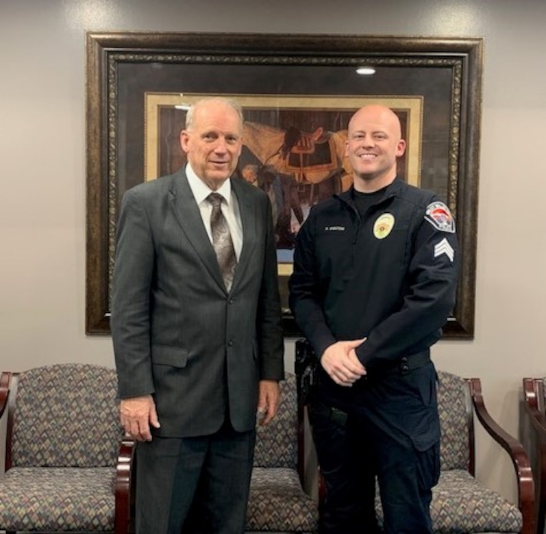 West Valley City Police Sgt. and member of the 419th Fighter Wing, Air Force Reserve, Robert Brinton, stands beside WVC Mayor Ron Bigelow. West Valley City recently received the Secretary of Defense Employer Support Freedom Award, the highest award presented by the Secretary of Defense to a U.S. business.  Only fifteen employers per year receive this coveted honor.