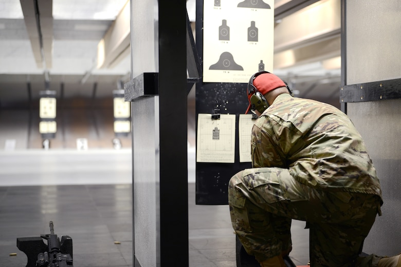 Staff Sgt. Keal Grable combat arms instructor from the 31st Security Forces Squadron, at Aviano Air Base, Italy, reviews a paper target, June 20, 2019. Grable taught an Air Force Qualification Course with 12 students. (U.S. Air Force photo by Airman 1st Class Ericka A. Woolever).