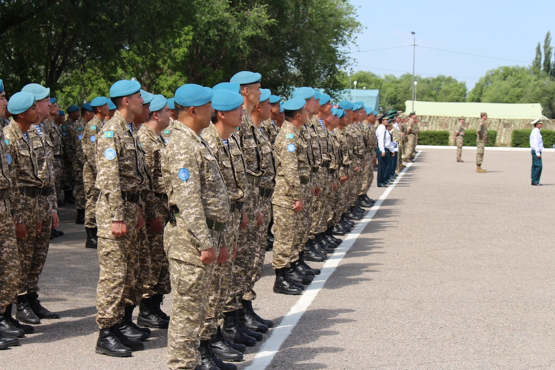 Kazakhstani Ground Forces' Soldiers stand in formation alongside Soldiers from other participating nations at the opening ceremony for Steppe Eagle 19, June 17, 2019, at Illisky Training Area near Almaty, Kazakhstan. Steppe Eagle 19 is a U.S. Army Central-led exercise that promotes regional stability and interoperability in the Central and South Asia region. (Photo by U.S. Army Maj. Kevin Sandell)